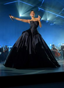 Rihanna Performing in Beverly Hills, California at the First Annual Diamond Ball Wearing a Custom Zac Posen Gown