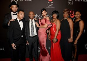 Rihanna and family pose on the red carpet (grandfather to her left) at the first annual Diamond Ball in Beverly Hills, California -- Direct Lyrics