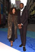 Gabrielle Union in Rodarte, Stella Luna Shoes, and Monique Pean Jewelry with Dewayne Wade in Gucci -- WWD