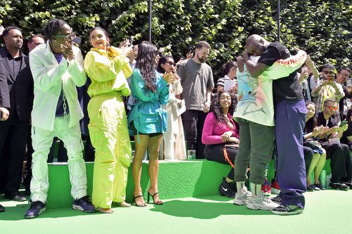 Abloh and West embrace at the Louis Vuitton Mens SS19 finale - a moment solidifying urban inclusion in high fashion. Also pictured: (l to r) Travis Scott, Kylie Jenner, Kim Kardashian and Jordyn Woods