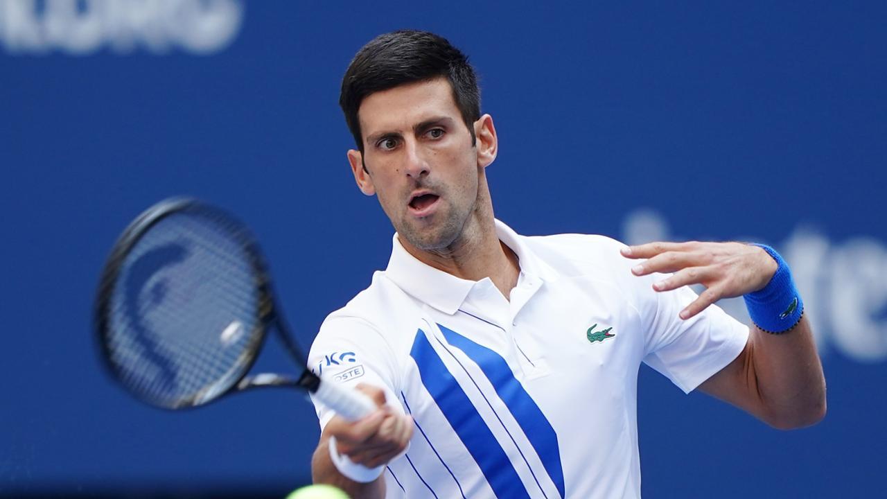 "alt=""Novak Djokovic battles P.Carreño Busta at US Open"""
