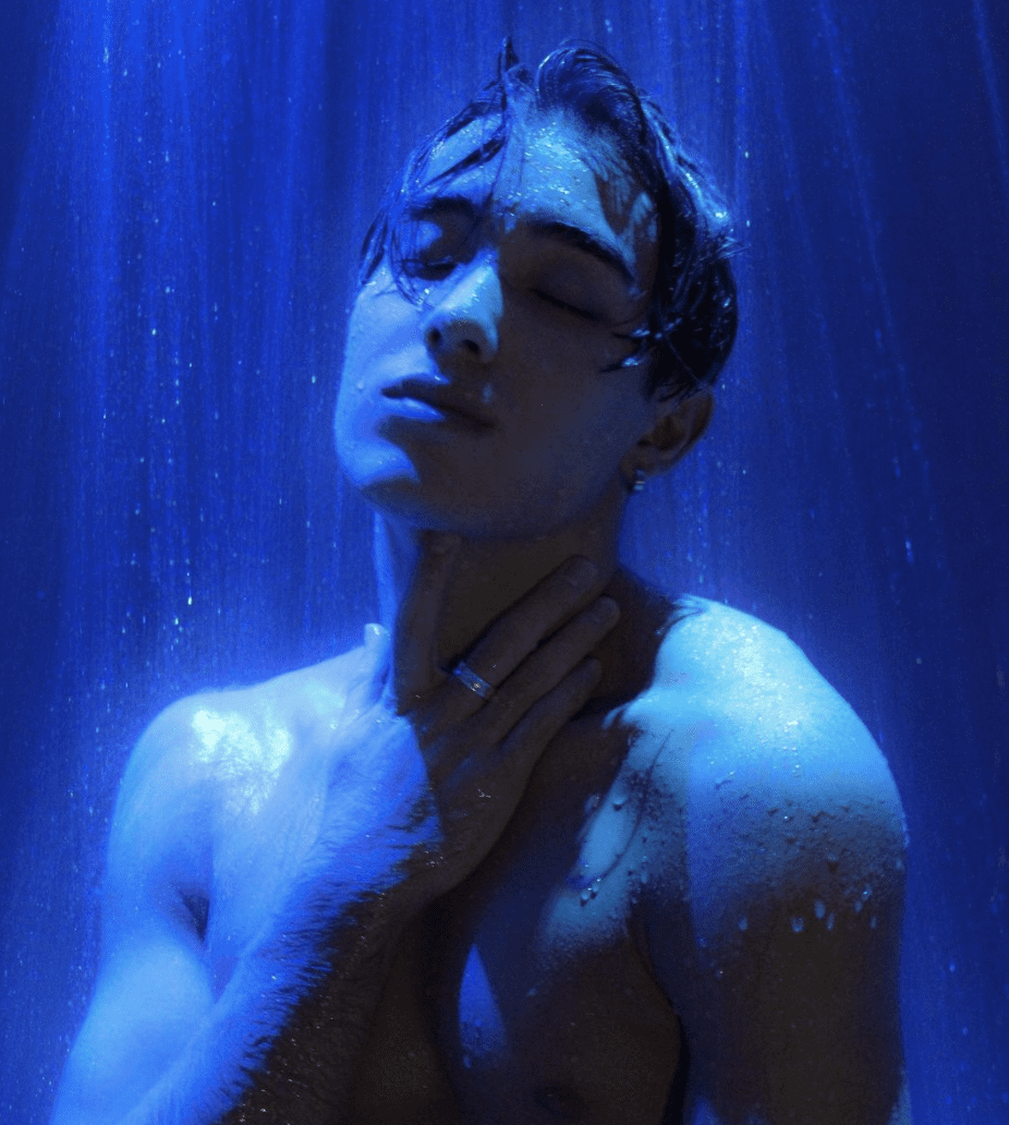Photo of Neil Shibata via his Instagram of him under running water with blue lights