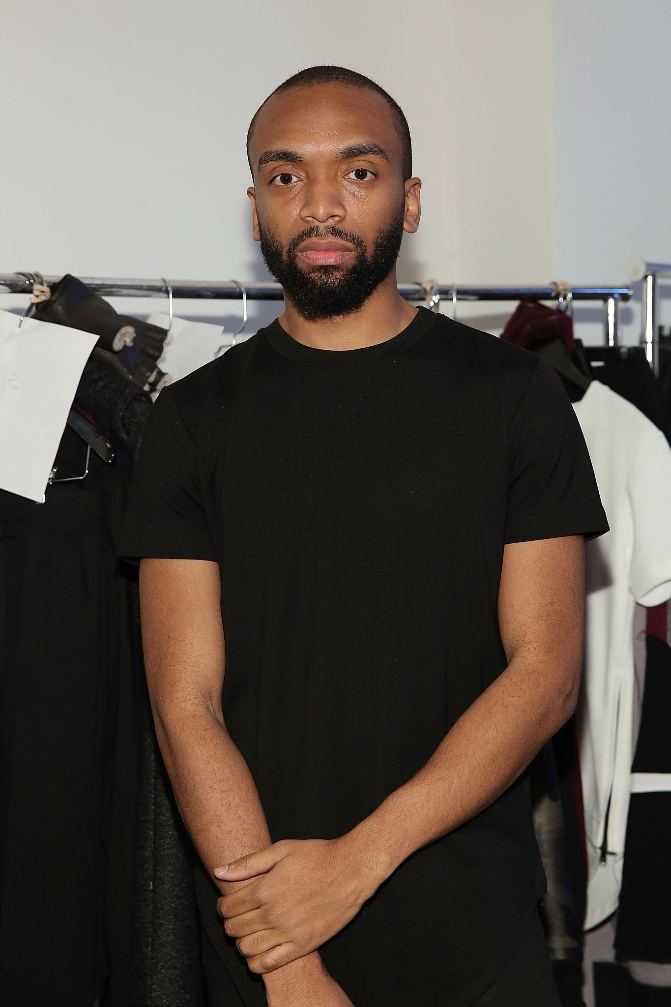 Pyer Moss designer Kerby Jean-Raymond posing for a photo
